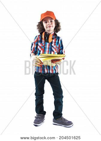 Little Curly Boy Builder Foreman Stands In An Orange Cap Holds A Workbook  . White Background
