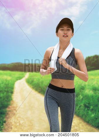 Healthy Woman Running In Countryside