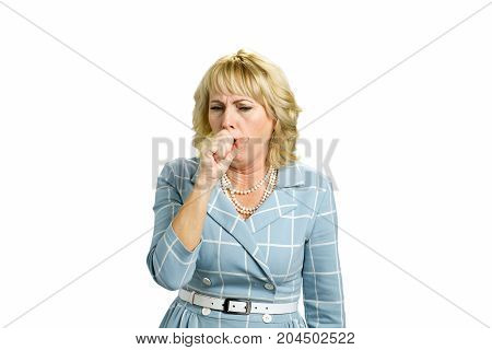 Mature woman coughing into her hand. Middle aged woman is suffering from cough. Concept of chronic cough. poster