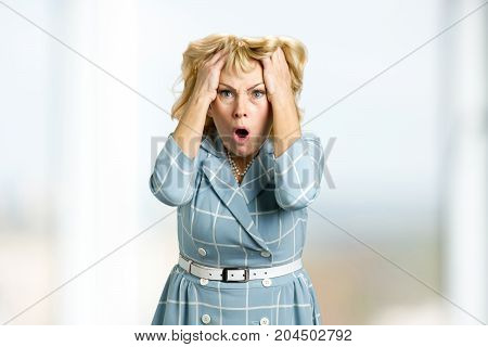 Portrait of frustrated mature woman. Middle aged woman shocked in full disbelief. Human facial expressions and body language.