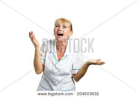 Portrait of astonished medical doctor. Mature female doctor looking surprised with open mouth and spreaded hands. Human facial expressions.