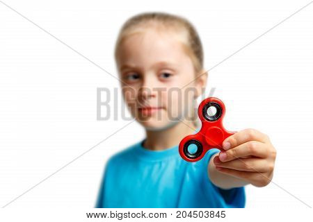 Little girl play with modern finger spinner..New spinning device.Play balance game with popular rotating gadget on bearings