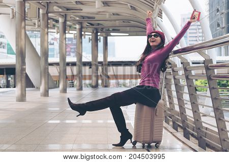 Happy Woman Traveller At Airport Walkway