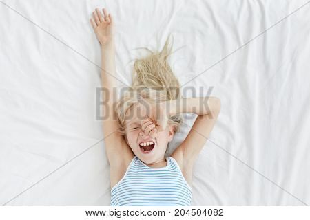 Lovely Blonde Small Child Wake Up Early In Morning, Yawn As Wants To Nap, Have Not Enough Sleep, Pla