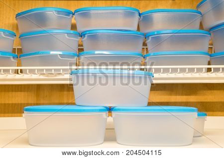 Blue plastic boxes of various sizes sold in cookware stores. Plastic can be used to store different types of food as well. Suitable for women who love to organize the kitchen.