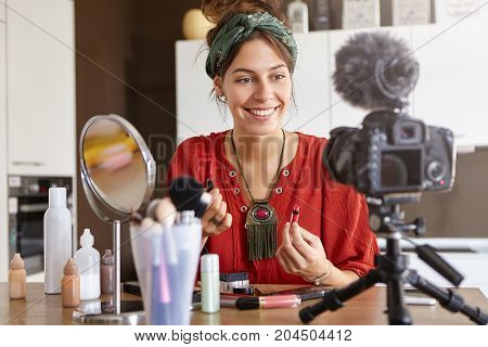 Video Blogging Concept. Attractive Young Woman Sitting In Shooting Area, Having Web Television Suppo