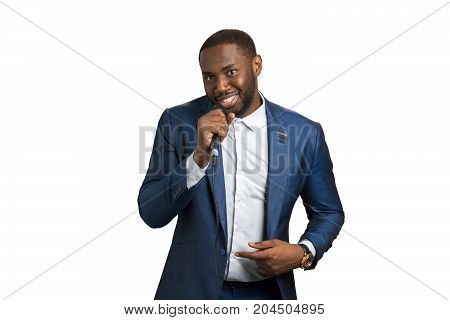 Smiling black man hold microphone. Elegant afro american man in music studio. Black jazz singer on white background.