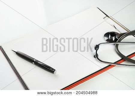 Stethoscope And Clipboard With Blank White Sheet Of Paper