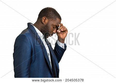 Stressed businessman with strong headache. Young black man feeling terrible headache. Tired and depressed manager with headache.