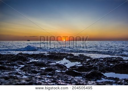 View from the ground on sunrise in the sea.