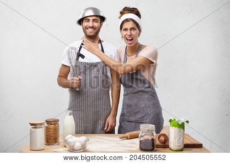 Annoyed Female Keeps Hand On Husband`s Neck, Asks To Help With Cooking Tasty Dinner. Pretty Woman We