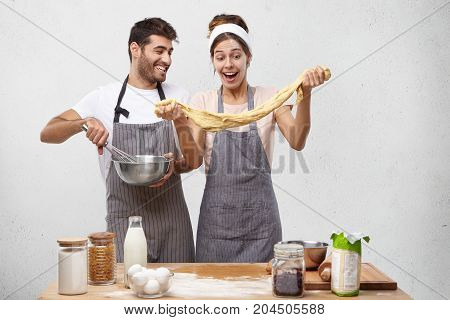 Two Workers Of Bakery Make Dough For Tasty Pastry, Work Together As Team, Mix All Ingredients, Have