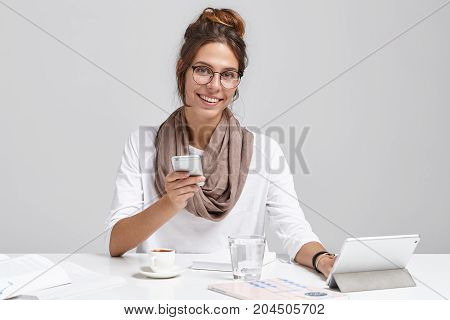 Candid Shot Of Happy Modern Busy Young Female Financial Analyst Sitting At Desk In Front Of Digital