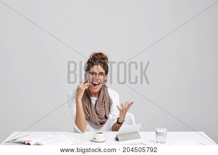 Portrait Of Angry Young European Businesswoman In Eyewear Gesturing And Screaming In Despair And Fur