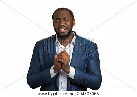 Businessman in desperate asking for help. Crying businessman with clasped hands near chest, open mouth and clothed eyes. Deep depression and stress.