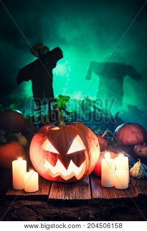 Orange Pumpkin With Scarecrows On The Field For Halloween