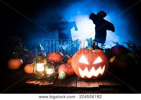 Spooky Halloween Pumpkin With Blue Mist And Scarecrows