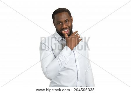 Black man sensual holding thumb on lip. Afro american man in formal wear looking sexy putting his thumb on lower lip. Concept of sensual men.