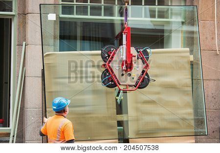 Installation of shop window. Construction of building