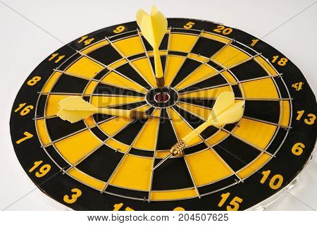 Yellow Dart Arrow Hitting In The Target Center Of Dartboard.
