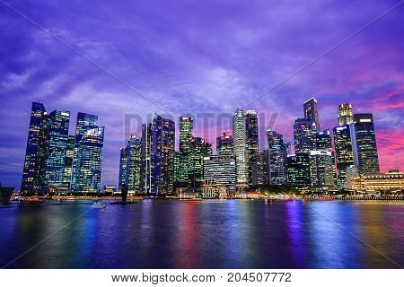Central Business District Building Of Singapore City At Sunset