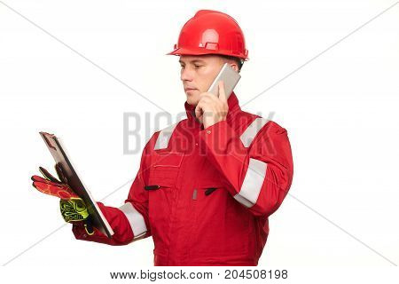 Construction Worker In Red Uniform And Safety Helmet