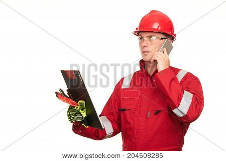 Construction Foreman With Clipboard Using Smartphone