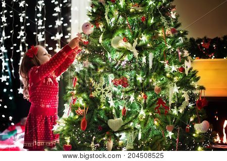 Child Decorating Christmas Tree. Xmas For Kids