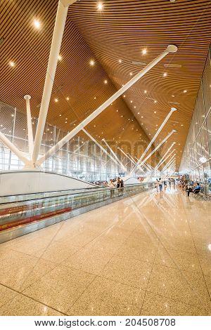Kuala Lumpur Malaysia - July 22 2017: Inside of Kuala Lumpur International Airports (KLIA) terminal with many people are waiting to transfer the international flight.