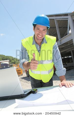 Happy worker on construction site
