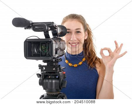 young woman with a video camera ready for filming isolated on white background