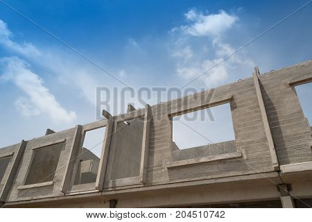 Prefabricated building isolated on blue sky background.