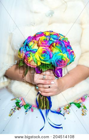 colourful wedding bouquet in bride's tender hands