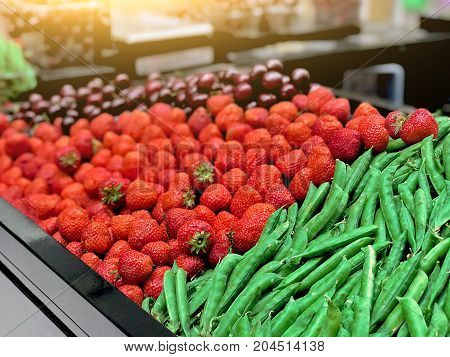 Strawberry, Peas, Cherries On The Counter In The Store