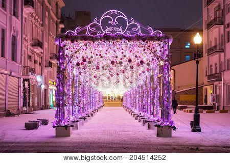 Arbat is an old street, is it a very popular pedestrian street in historical center of Moscow. Night view of the street on the New Year holidays