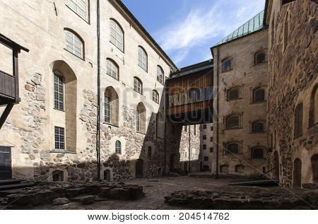 TURKU, FINLAND ON JUNE 30. Outdoor view of the Turku Medieval Castle from the 13th century on June 30, 2017 in Turku, Finland. Classical stone building. Editorial use.