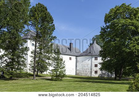 TURKU, FINLAND ON JUNE 30. Outdoor view of the Turku Medieval Castle from the 13th century on June 30, 2017 in Turku, Finland. Classical stone building. Unidentified people. Editorial use.