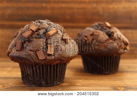 Chocolate chip muffins on wood in natural light
