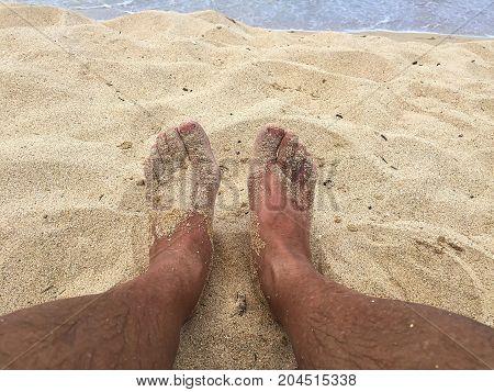 Sandy feet on vacation at a beach on Maui Hawaii