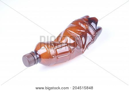 Crumpled Brown Plastic Bottle Isolated Over White