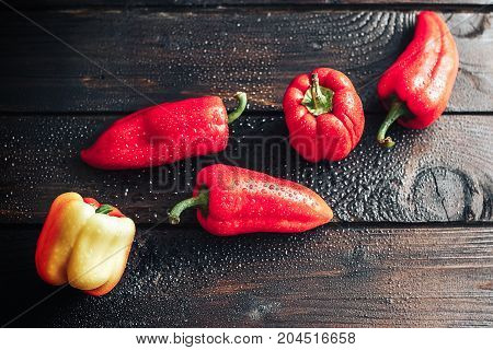 Bell Sweet Red Peppers Over Top On Wooden Background