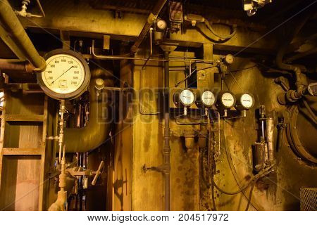 a series of pressure gauges set in a industrial setting.