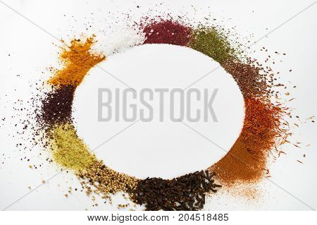 Circle Frame Composition Of Spices And Herbs Isolated On White