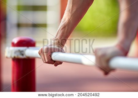 Muscular man during his workout on the street. Healthy lifestyle.