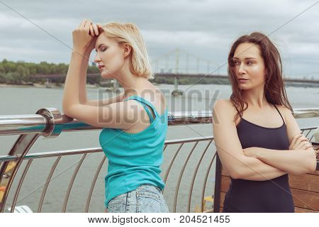 The women are standing on the bridge they quarreled.