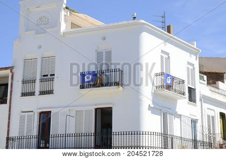 CADAQUES, SPAIN - JULY 27, 2017: Independece flags on white building in Cadaques province of Girona Catalonia Spain.