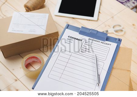 Delivery receipt on cardboard box at table