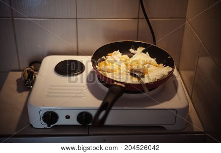 Portion of fried eggs in frying pan breakfast meal.