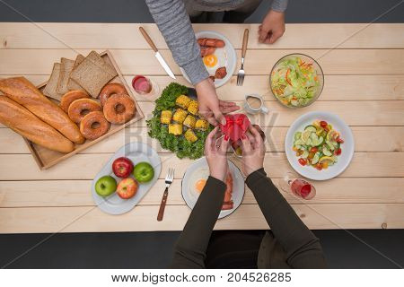 Top View Of Couple Have Romantic Evening In Restaurant