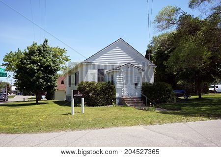 BAY VIEW, MICHIGAN / UNITED STATES - JUNE 13, 2017: A small former church building now houses North Country IT.